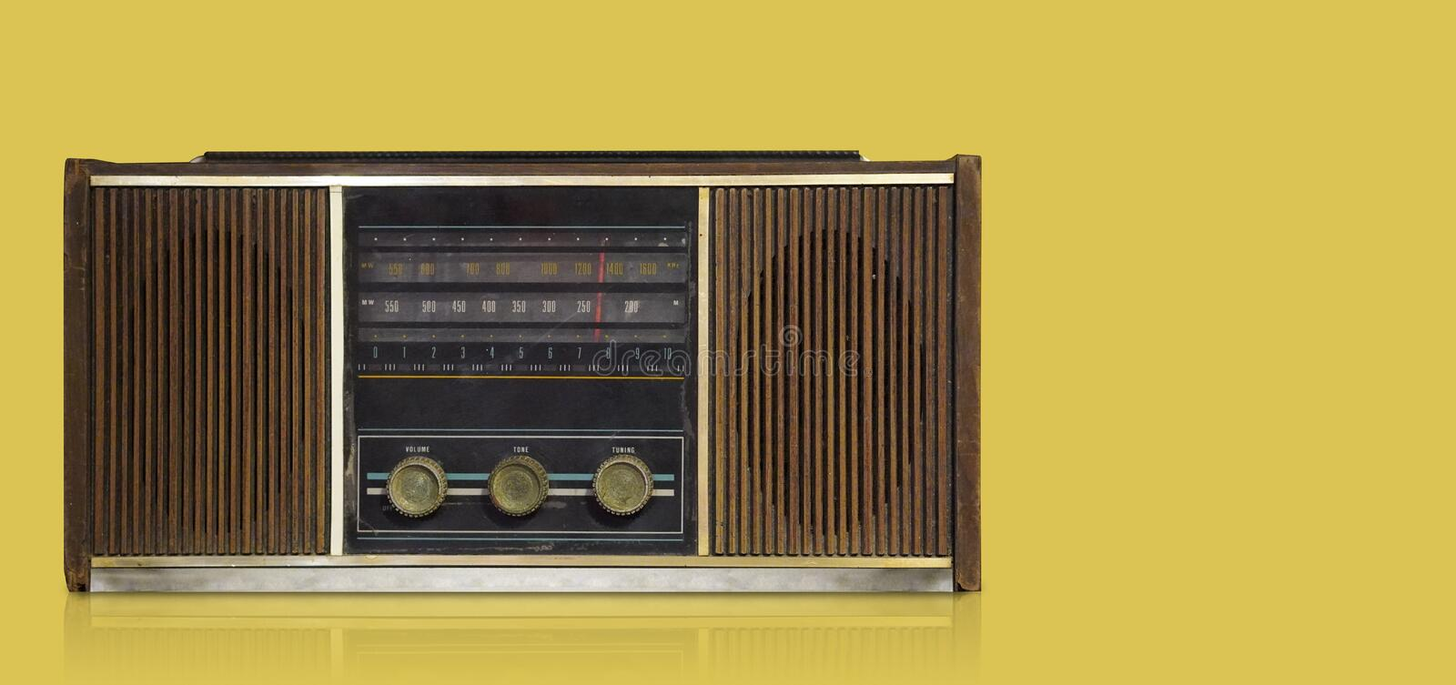 Front view antique brown radio on yellow background,technology background,copy space stock photo
