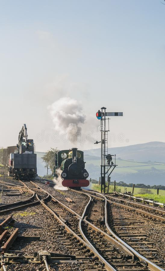 Front view of approaching steam engine `Blanche` at Woody Bay station stock images