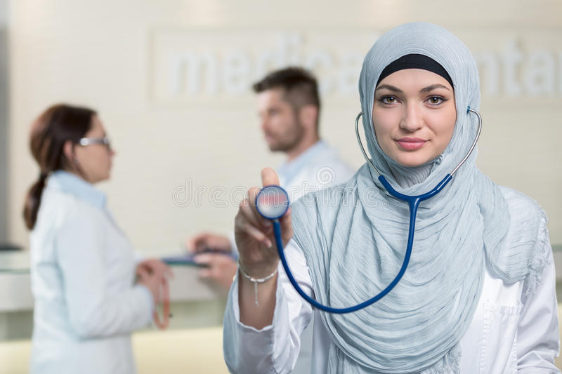 Front view of an arab doctor woman showing stethoscope. Front view of an arab doctor women showing stethoscope stock photo