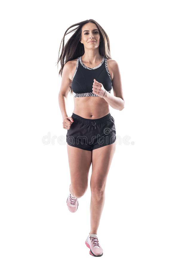 Front view of attractive healthy fit young sporty woman jogging towards camera stock photos