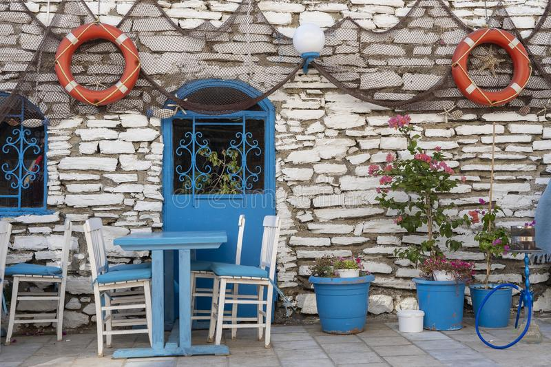 Front view of beach cafe exterior. Table and empty chairs outdoor near the stone wall. Tourist places. Typical Mediterranean. Restaurant, a place holidays in royalty free stock photography