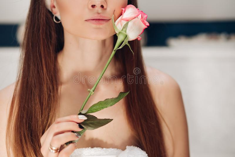 Front view of tender woman after shower caring about skin. Front view of beautiful tender woman after shower caring about skin in morning. Young long haired lady stock images
