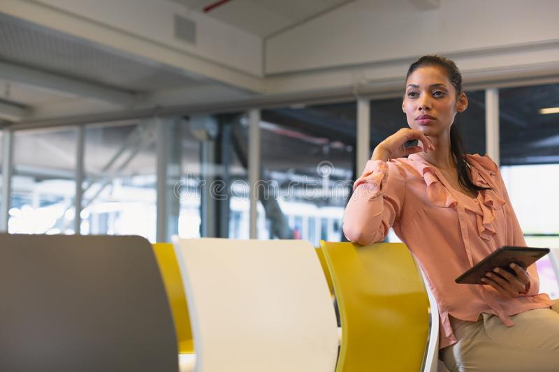 Businesswoman using digital tablet in the conference room royalty free stock image