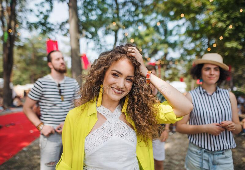 Front view of beautiful young woman at summer festival. royalty free stock photography