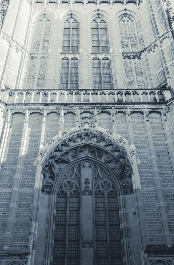 Front view of a big church with a tower and clock close-up black and white. Historic royalty free stock photo