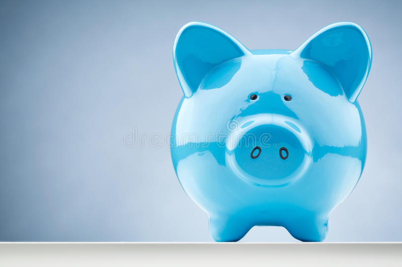 Front View of a Blue Piggy Bank. Front closeup image of a blue piggy bank with copy space stock photo