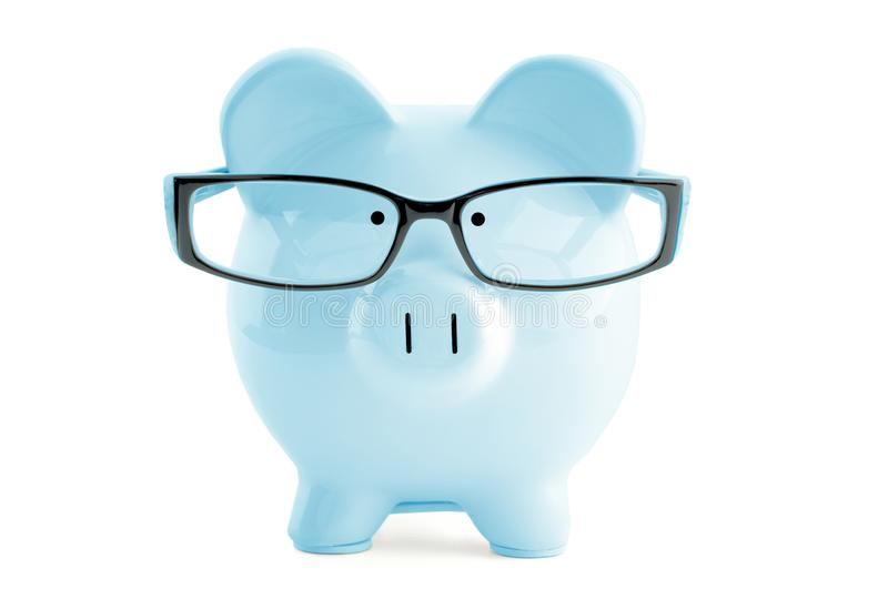 Blue piggy bank in in glasses on white. Front view. Blue piggy bank in glasses on white stock image