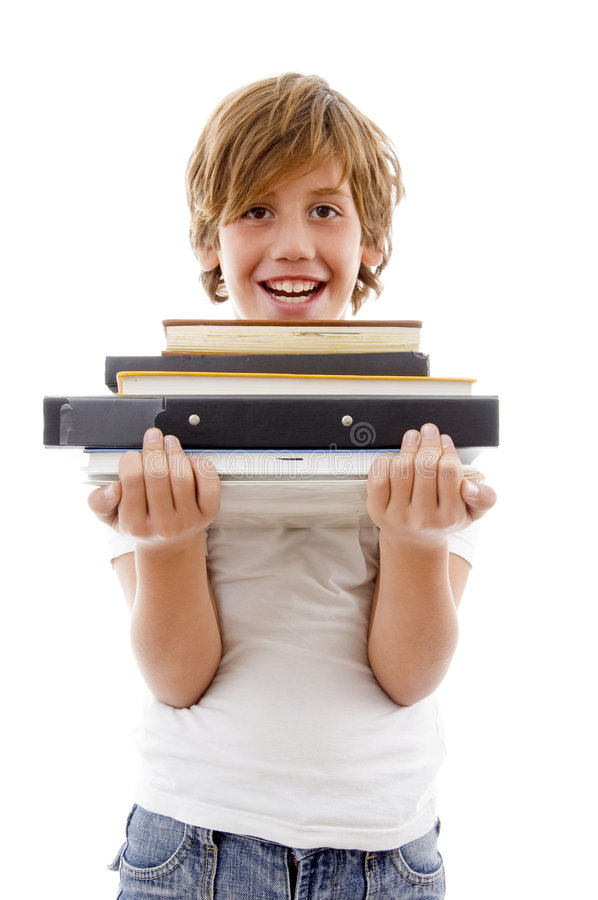 Front view of boy holding books stock photo