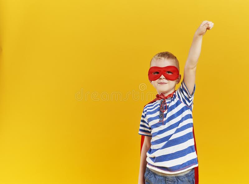 Child wearing a superhero costume royalty free stock image
