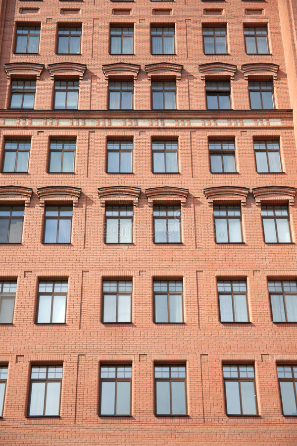 Download Front View Of Brick Wall Contemporary Apartment Building With Windows Stock Image