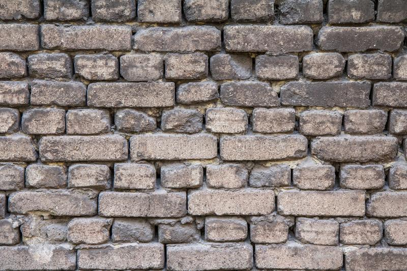 Front view of brick wall in gray color stock photo