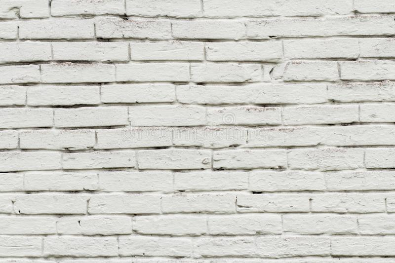Front view of brick wall painted in white color stock images
