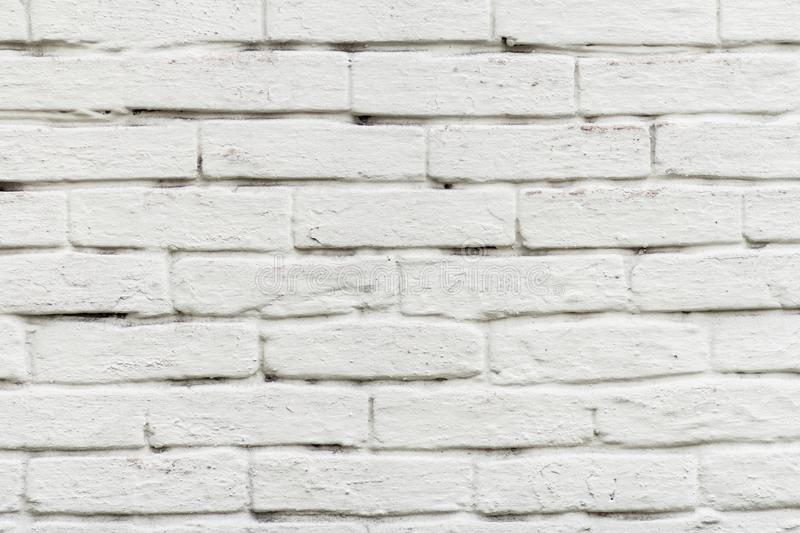 Front view of brick wall painted in white stock image