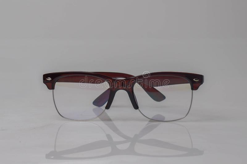 Front view brown glasses on white background,copy space stock photography