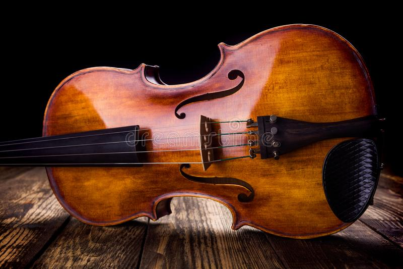 Front view of a brown violin stock image