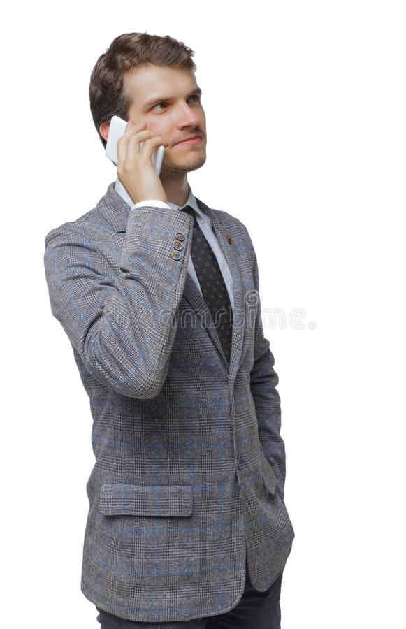 Front view of business man in suit  talking on mobile phone stock photos