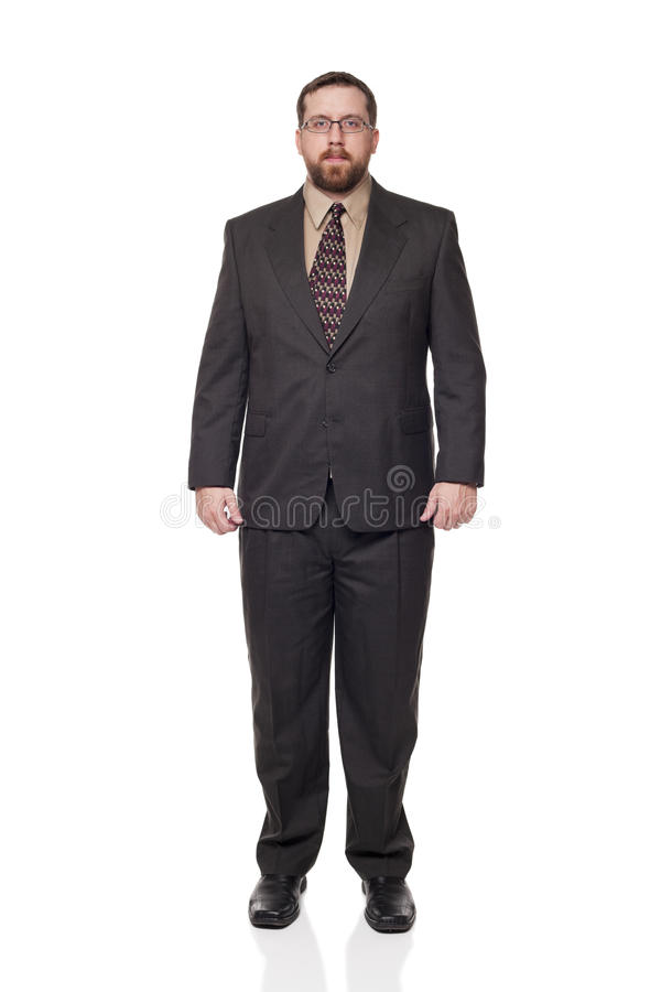 Front view businessman full length. Isolated full length studio shot of the front view of a businessman in full suit looking at the camera royalty free stock images