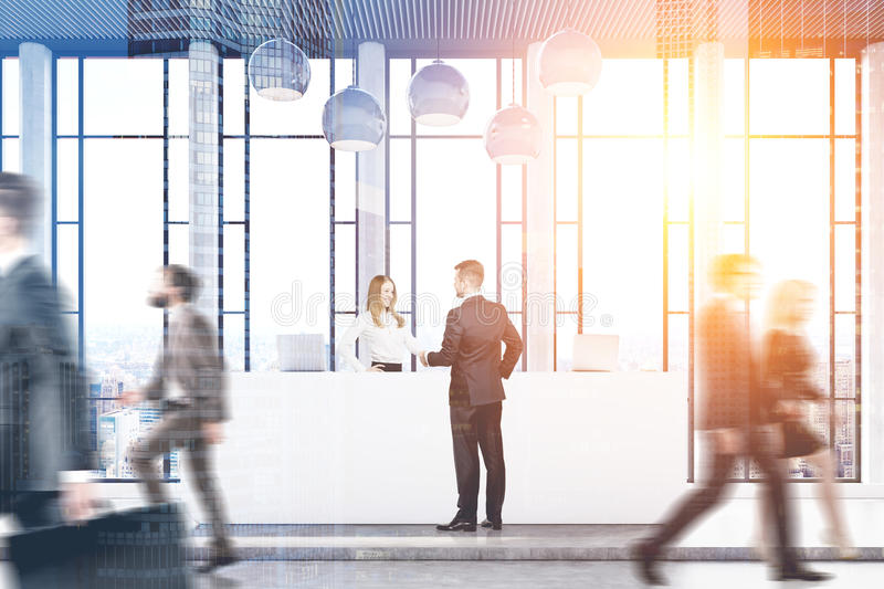 Front view of businesspeople. Passing by a reception counter in an office with panoramic windows. 3d rendering, toned image, double exposure stock photos
