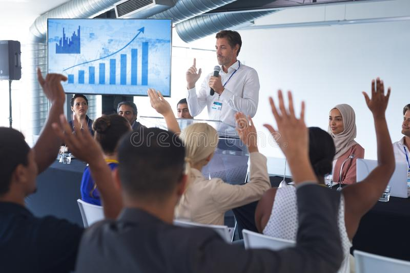 Male speaker speaks in a business seminar royalty free stock photography