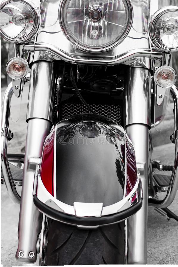 Front side of classic motorcycle/ Chrome and black paint motorcycle/ Classic chopper with big headlights and chrome plate stock images