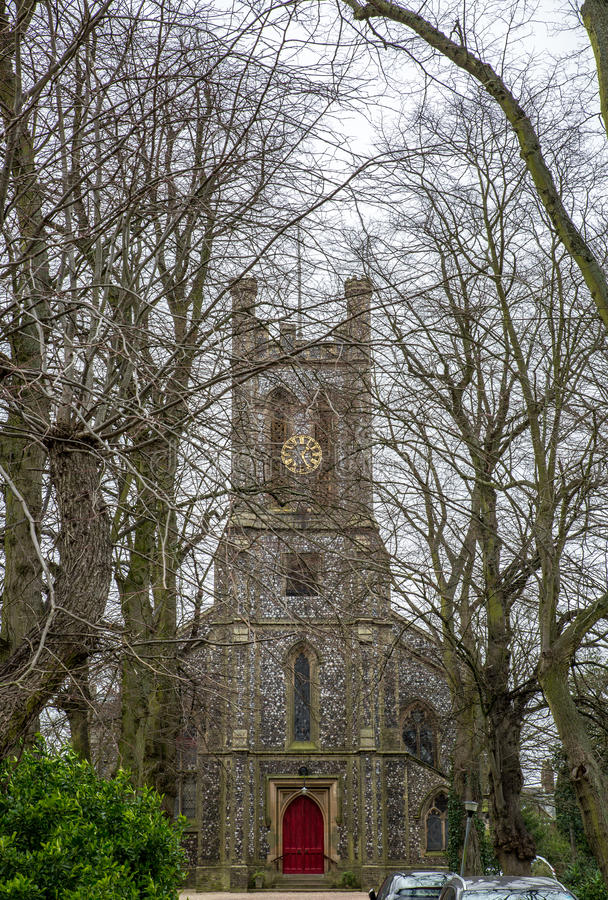 Front view of a church in the middle of a cemetery in England, royalty free stock photo