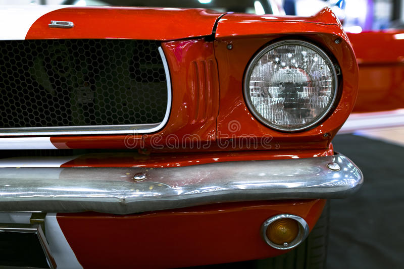 Front view of Classic retro Ford Mustang GT.Car exterior details. Headlight of a retro car. Sankt-Petersburg, Russia, July 21, 2017: Front view of Classic retro stock images