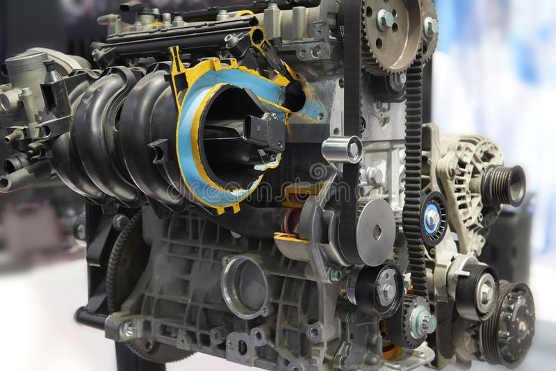Front view on clean car engine toothed belt, pulley, electric equipment, engine components. Engine with cross section. Close up ca. R motor components details royalty free stock image