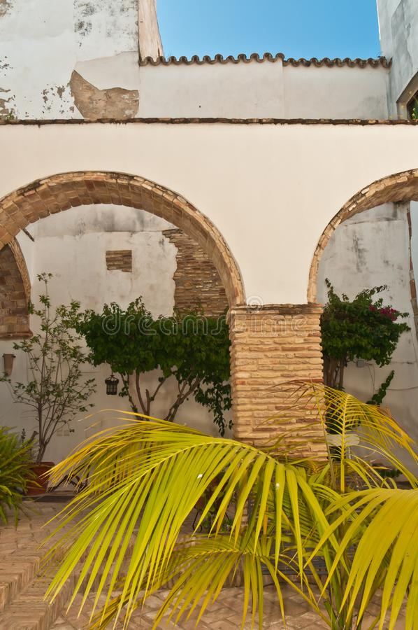 Archway of open courtyard of a vintage hotel. Front view, close distance of an artisan, brick, archway of open courtyard of a vintage hotel in Cadiz, in the late royalty free stock photography