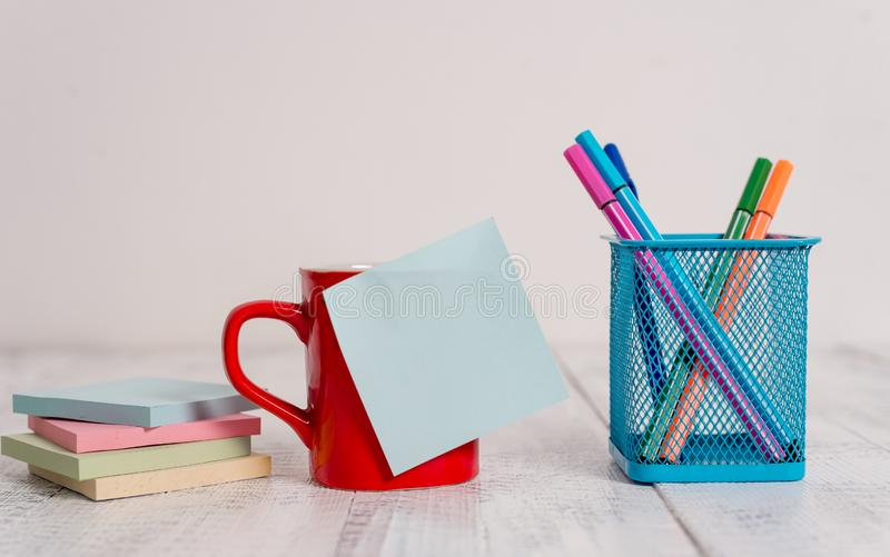 Front view coffee cup mug hot drinks blank colored sticky note pens metal holder stacked note pads lying retro vintage royalty free stock photo