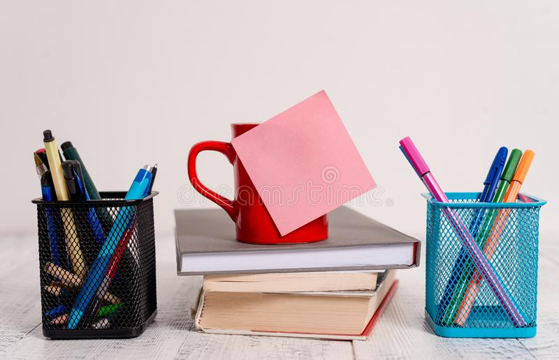 Front view coffee cup mug hot drinks blank colored sticky note stacked piled books pen metal holders lying retro vintage royalty free stock photos