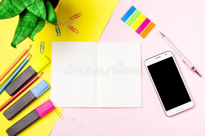 Front view colour pencils smartphone notepads on yellow background. Empty text important future events. What to do home school stock images