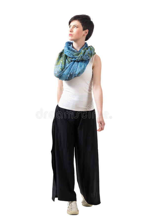 Front view of confident fashion model walking forward looking up. royalty free stock photo