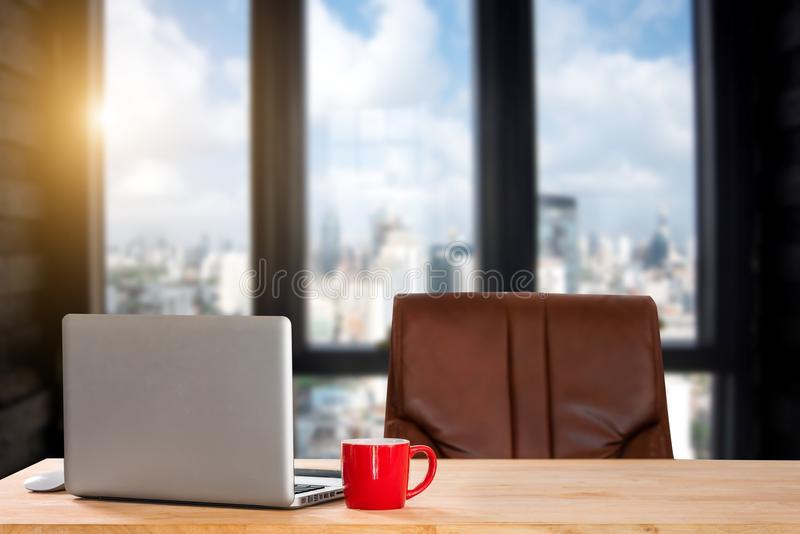 Front view of cup and laptop on table stock image