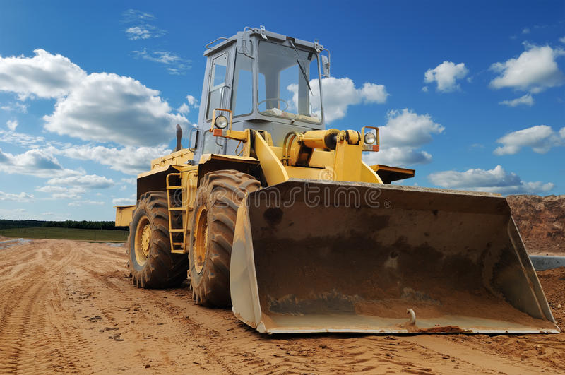 Front view of diesel wheel loader bulldozer royalty free stock image