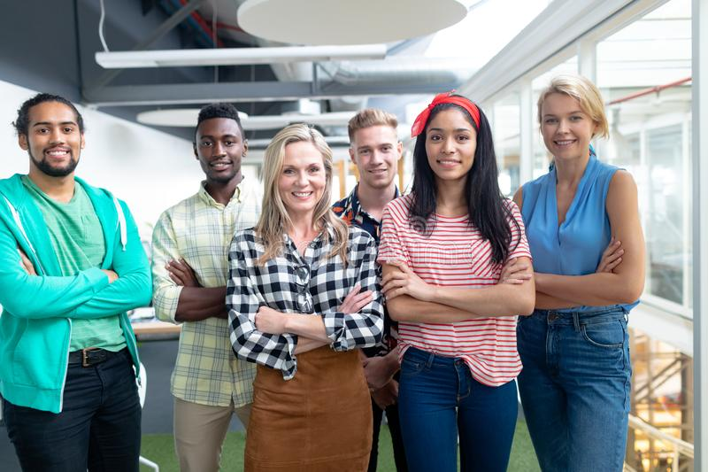Business people with arms crossed looking at camera in a modern office royalty free stock photography