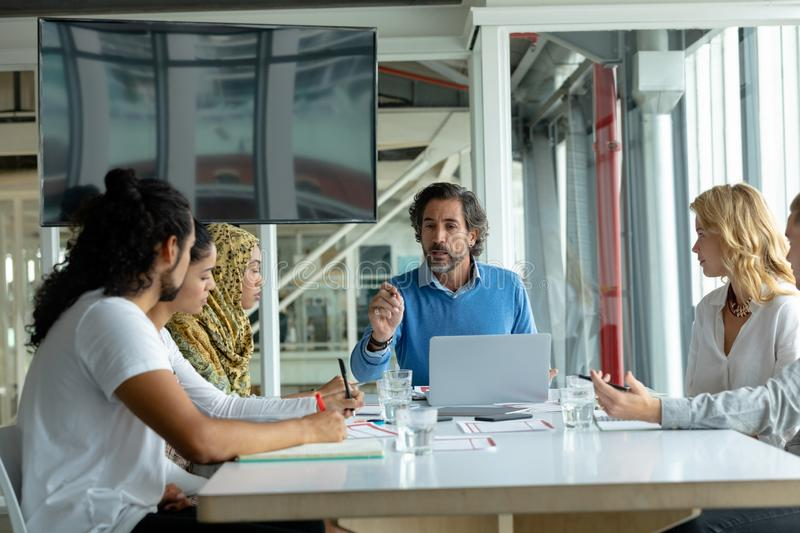 Business people discussing with each other in meeting at conference room in a modern office stock photos