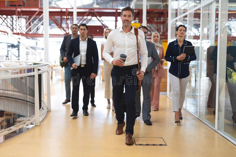 Business people walking together in a modern office royalty free stock images