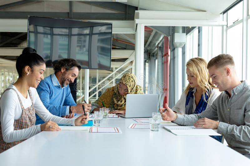 Business people working together in meeting room in a modern office royalty free stock photography