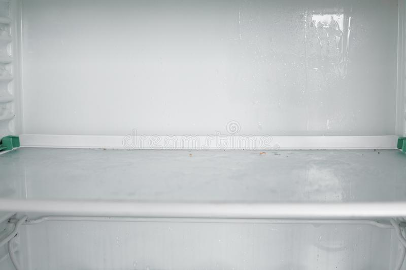 Front view of empty refrigerator staying at home royalty free stock images