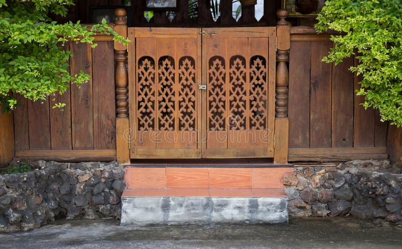 Front view of entrance wood carved door stock photography