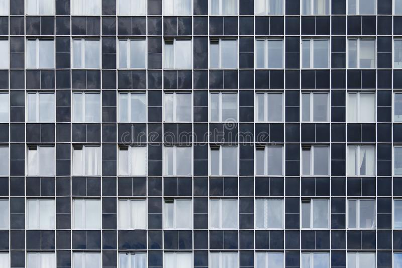 Front view on a facade of modern office building as texture, background royalty free stock photos