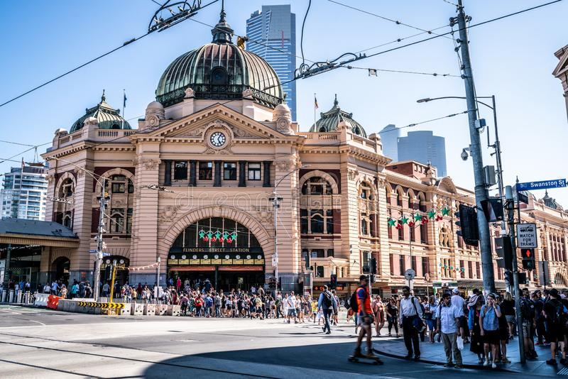 Front view of Flinders street railway station building entrance full of pleople in Melbourne Australia stock photography