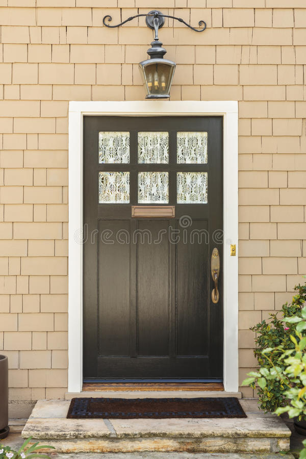Front view of front brown door stock image