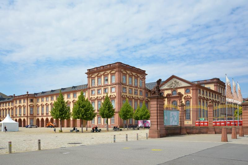 Front view with gates of Mannheim Baroque Palace on summer day stock photo