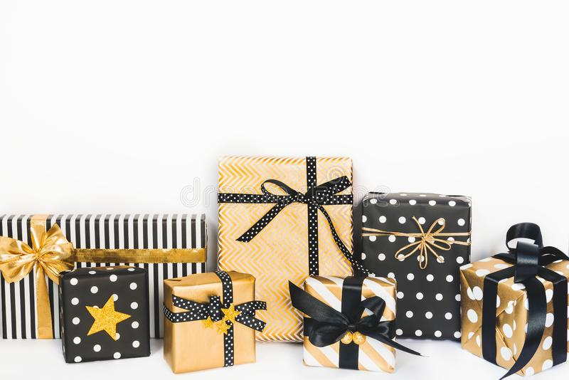 Front view of gift boxes in various black, white and golden designs. Copy space. A concept of Christmas, New Year, birthday celebr. Ation event royalty free stock images