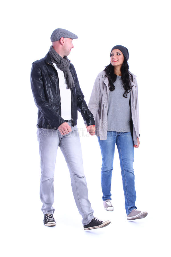Front view of going young couple walking stock photos