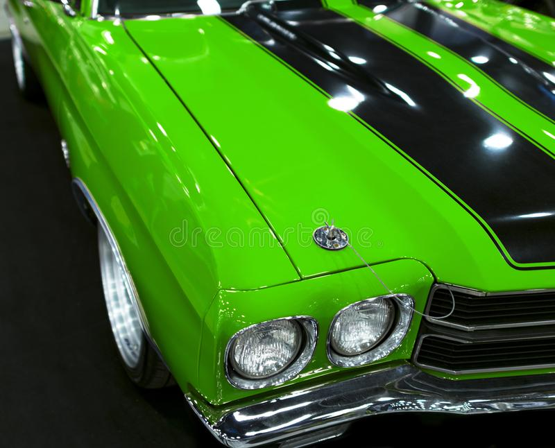 Front view of a great green retro american muscle car Chevrolet Camaro SS. Car exterior details. Sankt-Petersburg, Russia, July 21, 2017: Front view of a great stock image