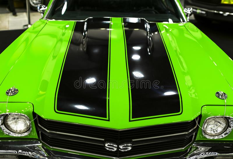 Front view of a green great retro american muscle car Chevrolet Camaro SS. Car exterior details. Sankt-Petersburg, Russia, July 21, 2017: Front view of a green stock image