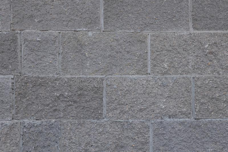 Front view of grey brick wall texture background. Tiled concrete cement surface. stock image