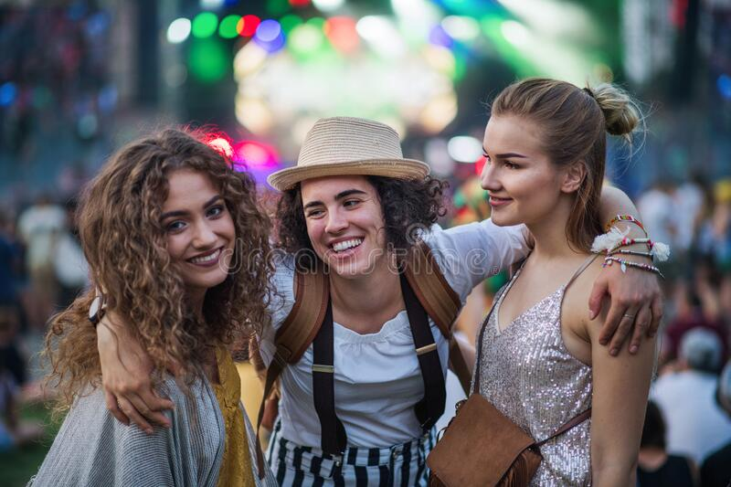 Group of young female friends standing at summer festival. stock photography